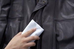 clean a leather jacket using damp cloth